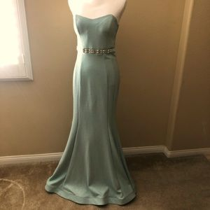 A Shimmering juniors blue gown with rhinestones